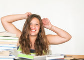 Exuberant, happy teen female student with books — Stockfoto