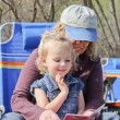 Grandma reading to toddler in park — Stock Photo
