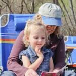 Grandma reading to toddler in park — Stock Photo #22192323