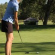 Female teen golfer putting home — Foto Stock