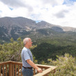 Stock Photo: Senior on mountain overlook