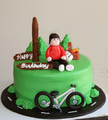 Bicyclist green birthday cake — Stock Photo