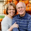 Stock Photo: Senior couple with pumpkins