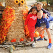 Kids with giant owl scarecrow — Stock Photo