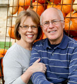 Senior couple with pumpkins — Stock Photo