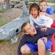 3 scared kids with land shark — Stock Photo