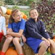 3 happy kids at pumpkin patch — Stock Photo