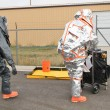 Men approaching hazmat site — Stock Photo #35144623