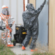 Stock Photo: Men testing hazmat site door