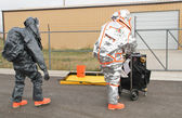Men approaching hazmat site — Stock Photo