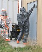 Men testing hazmat site door — Stock Photo