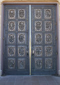 Historic Bronze cathedral doors — Stock Photo