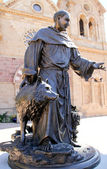 Life size bronze St. Francis statue — Stock Photo