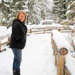 Senior female on snow covered trail — Stock Photo #51384311