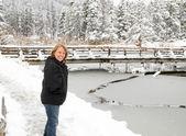 Senior female on snow covered trail — Stock Photo