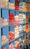 Colored yarn skeins in a bin — Foto de Stock