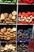 Seventeen colored yarn skeins in a bin — Foto de Stock