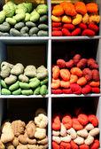 Fifteen bright colored yarn on display — Foto de Stock