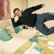Mlevitating above his bed — Stock Photo #12723064