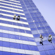 Workers cleaning building windows — Stock Photo