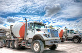 Mixer truck with a beautiful cloudscape in the background — Stock Photo