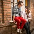 Young couple in the city — Stock Photo