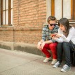 Young urban couple sharing information — Stock Photo