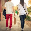 Young urban couple shopping in the city — Stock Photo