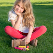 Little blond girl in garden — Stock Photo #33734447