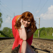 Stock Photo: Beautiful girl crawl on rails