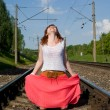 Beautiful girl standing on the rails — Stock Photo