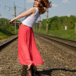 Stock Photo: Beautiful girl walks on rails