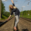 Blonde girl goes on rails — Stock Photo