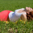 Beautiful girl rests in the meadow — Stock Photo #12407050