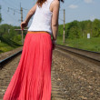 Redhead girl walks on the rails — Stock Photo