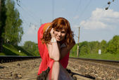 Beautiful girl crawl on rails — Stock Photo