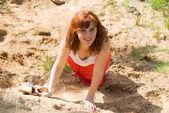 Girl, crawling through the sand — Stock Photo
