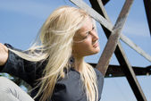 Beautiful blonde girl lying on the iron — Stock Photo