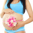 Big bow on her stomach pregnant girl — Stock Photo #13628101
