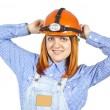 Business girl in a helmet and robes — Stock Photo
