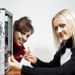 Girls computer repair - Stock Photo