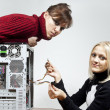 Girls repair the system unit - Stock Photo