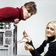 Royalty-Free Stock Photo: Girls repair the system unit