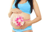 Big bow on her stomach pregnant girl — Stock Photo