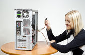 Girl repairing the system unit — Stockfoto