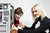 Girls computer repair — Stock Photo