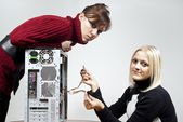 Girls repair the system unit — Stock Photo