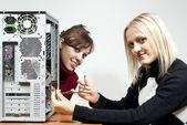 Two girls repairing computer — Stock Photo