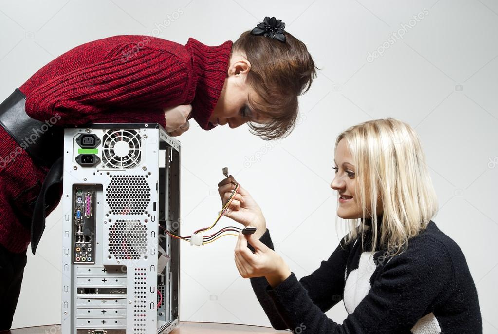 Girls repair the system unit  Stock Photo #13628035
