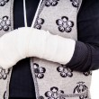 Stock Photo: Womwith broken arm
